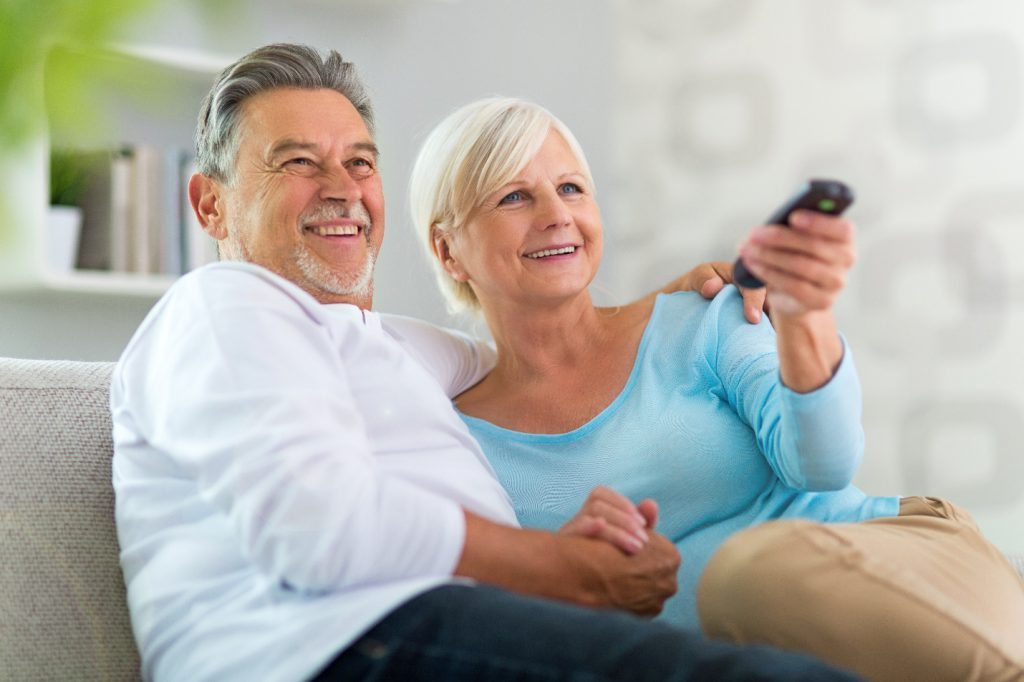 senior couple with remote control
