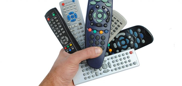 man hand holds six remote control
