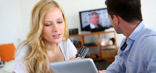 Young couple choosing tv program on internet