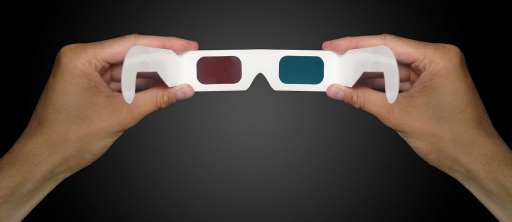 man hand holding 3D glasses