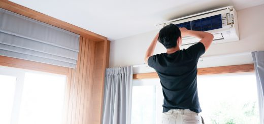 Technician repairing and maintenance Air conditioner