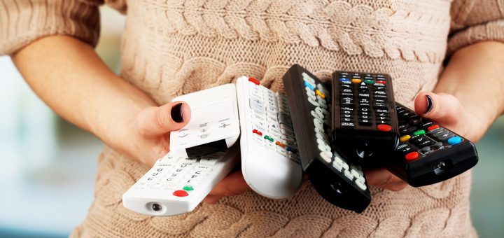 Many remote control devices in in hands