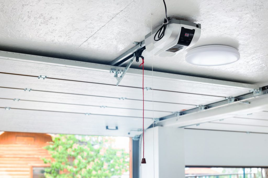 automatic garage door opener electric engine gear mounted on ceiling with emergency cord